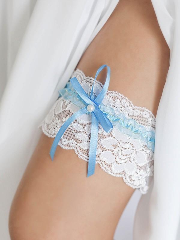 Подвязка с синим бантом 1